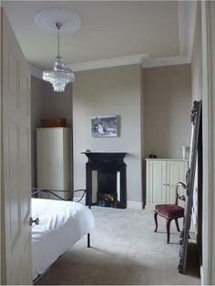 A calm and tranquil spare bedroom. Elephant's Breath walls and Dimity woodwork. Ceiling is Slipper Satin and the coving is All White. Furniture is painted in Off White.An inspirational image from Farrow and Ball