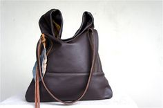 My friend in Eugene makes these leather bags by hand and they are AMAZING! check them out at arebycdesign.etsy.com
