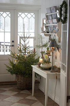 Cozy Canadian Cottage: Christmas in Sweden from Lantliv i Norregard. I love this entry. Potted Christmas Trees, Noel Christmas, All Things Christmas, Winter Christmas, Simple Christmas, Xmas Tree, Minimalist Christmas, Natural Christmas, Christmas Porch