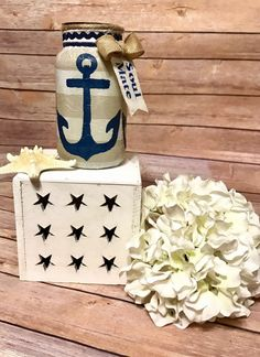 Decorated nautical mason jar with tea light holder on top