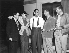 Thomas Mitchell, John Ford, Clark Gable, Robert Montgomery and John Wayne