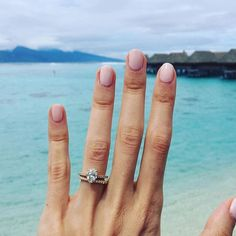 "It's only natural to want to take a ""just married"" #BridesRings ring selfie in a breathtaking honeymoon locale: Moorea 