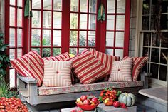 Add some bright red pillows to your porch swing for an extra punch