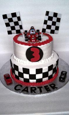 Race Car cake....theme will go great with Eli's crash helmet!!