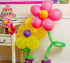Balloon flowers! Easy & awesome blossoms for a Dora party and lots of other party themes.
