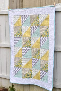SALE, Modern Baby Quilt for Boy or Girl: Aqua, Yellow and Gray Triangles. $68.50, via Etsy.