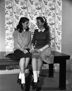 The girl on the left is wearing a sloppy joe oversized loose sweater from 1946.