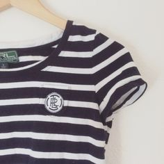 Ralph Lauren striped shirt (Closing 7/15) Cute striped short sleeve tee from Ralph Lauren, with cool emblem on pocket. Very classic, good condition. Make an offer using the offer button!  NO trades or model Ralph Lauren Tops Tees - Short Sleeve