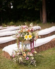 Quilt-covered hay-bale seats for the ceremony