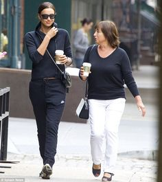 Best foot forward: Russian model Irina Shayk took her mind off of boyfriend Bradley Cooper's absence by heading to the shops with her mum for some retail therapy