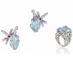 A SUITE OF AQUAMARINE AND DIAMOND JEWELLERY, BY DIOR. Comprising a dress ring with central oval-cut aquamarine to a brilliant-cut diamond pierced leaf motif surround, with further pink sapphire and mother-of-pearl-set dragonfly accent, raised on chased shoulders and plain hoop; together with earrings of matching design, finger size M, 2.4cm long, maker's case. Each signed Dior and no.032462 54 and J1388 respectively