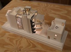 Completed model of a Chicago residence. We made this architectural model by making 3D drawings and prints, moulding and casting in white plaster and adding etched metal details and LED lighting.