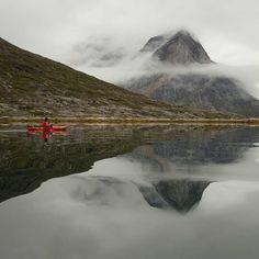 Tranquil kayaking on the Greenlandic fjords. #arctic #greenland #kayaking