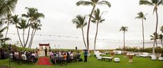 After the wedding ceremony, guests can enjoy cocktails and appetizers on the lawn while the bride and groom take photos on the beach | photo: Kaua Wedding Photography