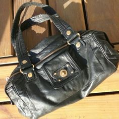 """Marc by Marc Jacobs Leather Satchel Marc by Marc Jacobs Leather Satchel...gorgeous medium (8x13"""", 10"""" handle drop) sized black soft italian leather satchel with 2 pockets on each end and small one on front..all brass MJ turnlock hardware...small signs of use on zipper hardware otherwise in excellent condition Marc by Marc Jacobs Bags Satchels"""