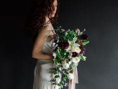 Benjamin Holtrop Photography; purple cascade bouquet by Moss Floral/Selva