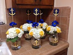 White yellow blue flower arrangement for a nautical theme baby shower