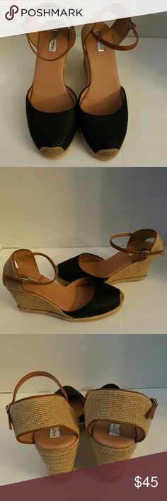 Halogen shoes size 11 Halogen black and tan wedge espadrilles size 11. These shoes are great for the upcoming spring. They were worn once inside. Halogen Shoes Wedges