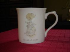 """#Enesco #Precious_Moments The #Lord_will_Provide mug #1985  This mug looks like new but we don't have the box so we can't certify that it wasn't used   The picture is a small girl sowing seeds with birds feeding at her feet. The picture is only on the front of the mug, not the rear.   This mug measures 3 1/2"""" (8.9 cm) high x 3 1/4"""" (8.3 cm) at the brim   This item has no nicks, chips, cracks, or signs of repair    01102012PENI27D"""
