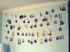Pictures of all of us and our fam's on the wall/ Hung up with wire and clothespins....cute for dorms!