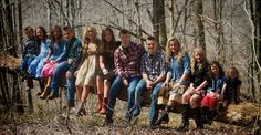 Willis Clan Parents Toby and Brenda with Jessica (21), Jeremiah (20), Jennifer (19), Jeanette (17), Jackson (15), Jedi (14), Jasmine (12), Juliette (10), Jamie (9), Joy Anna (7), Jaeger (4), and Jada (3).May 2014