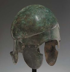 A GREEK BRONZE HELMET OF CHALCIDIAN TYPE  CLASSICAL PERIOD, CIRCA EARLY 4TH CENTURY B.C.