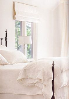 White linens | wrought iron bed