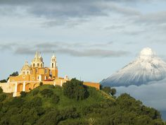 Santuario Nuestra Señora de los Remedios, a church built atop the pyramid temple of Cholula, is one of the best places to view Popocatépetl and Iztaccíhuatl volcanoes, Mexico's second- and third-tallest peaks.  Getty Images/iStockphoto