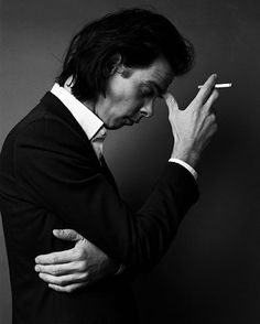 Nick Cave. With dark themes and a deep, lush voice, he's been making music for decades. He's also an author. Quite the man!