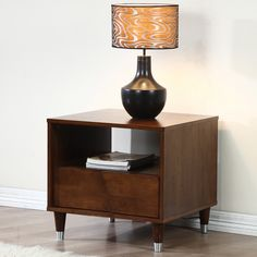 Complete any room with the vintage inspired Venus end table constructed of rubberwood and veneers. It features one drawer that sits on metal glides and an integrated pull.