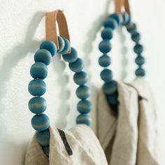 DIY Towel Ring with wood beads and a leather hanger (I think I might like this better as a trivet).