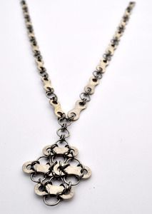 Diamond necklace. made from recycled bike chain, handmade stainless steel links. $58. www.wiredresistance.bigcartel.com
