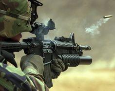 M203 Grenade launcher, mounted under an M4