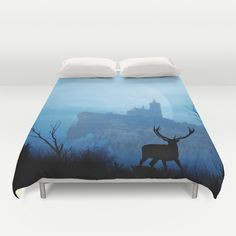Stag moon Duvet Cover by Pirmin Nohr - $99.00 The deer watching a supermoon behind an old chapel on a huge rock. Photomontage of 5 of my photos  silhouettes, trees, elk bull, red deer, animal, landscape, historical building, clouds, sky,  mystical, chapel