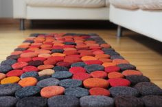 Unique Hand made Rug. Wool Felt Pebbles. Multi color. Orange, Red, Gray  colors. Size 55 x 23,5 inches.Gray /Orange colors. $250.00, via Etsy.