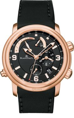 Blancpain Leman GMT Alarm Date 2841-36B30-64B.The Blancpain Leman GMT Alarm rose gold watch features a black dial and hour markers, a dual time zone display at 3 o'clock, a date display at 5 o'clock, a sub second display at 6 o'clock, a power reserve indicator between 9 and noon, and the alarm display at 1 o'clock, in a 40mm case on a black rubber strap. the Blancpain Leman GMT Alarm watch also features a self-winding movement, a 40-hour power reserve, and water resistance to 100 meters.
