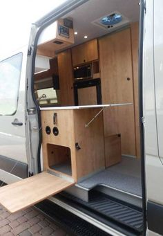 75f0427cfd Sportsmobile Transit Extended Body (EB) camper van conversion features  inside and outside access to the galley