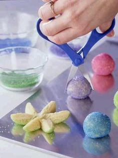 Spring Easter cookies:Roll sugar cookie dough into ball over pastel colored sugar. Place on cookie sheet and snip in middle one way and then again twice in different directions. Spread petals, place pastel mnm in center and bake.