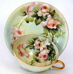 Tea cup and saucer, mint color with pink roses