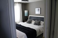 Simple Modern Bedroom. Obsessed with this greige wall!