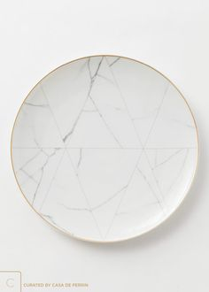 """13"""" A refined, geometric approach, inspired by the marble of Carrara. Lined in 24k gold."""