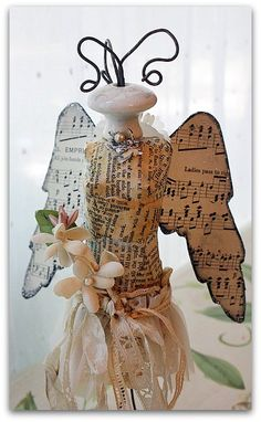drawer knob, wire, ribbon, music sheet paper, small flowers, would make a great Christmas decorationor just a gift wrapping decor idea