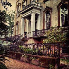 Wrought iron adorns this grand Savannah home... So beautiful!