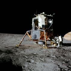 Apollo 12 Al Bean is working at the MESA and the S-Band antenna is at the right edge of the picture. The LM is sitting on the northwest rim of Surveyor Crater and a portion of the crater can be seen on the left side of the picture.
