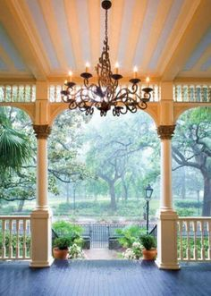 Love the chandelier on the porch making a elegant entry.