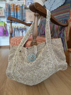More from our clever customers.  G made up this bag design and knitted it in paper yarn.