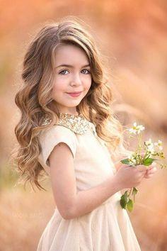 Flower girl with long loose curls @myweddingdotcom