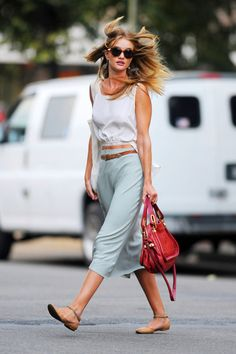 White top/blue-grey skirt/red purse/tan flats