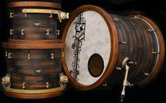 SJC Custom Drums -  Size: 11x13, 14x16, 20x22 10ply Birch w/ re-rings Finish: Hand layered knotty western red cedar w/ distressed paint job