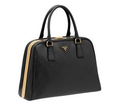 I fell in love with this Prada black saffiano lux pyramide bag in NYC.  One day she will be mine